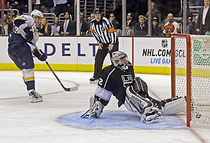 Sergei Kostitsyn watches as his shot goes past Jonathan Quick, which ends a lengthy shootout and gives Nashville the victory.  (AP)