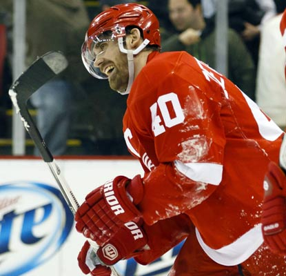 Henrik Zetterberg does the heavy lifting for Detroit, matching a career best with five points, including three goals.  (US Presswire)