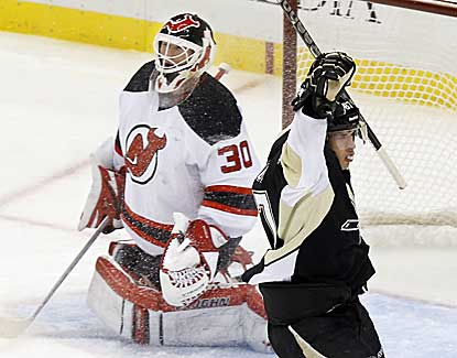 Sidney Crosby gets one past Devils goalie Martin Brodeur to lead the Pens to their first home victory of the season. (AP)