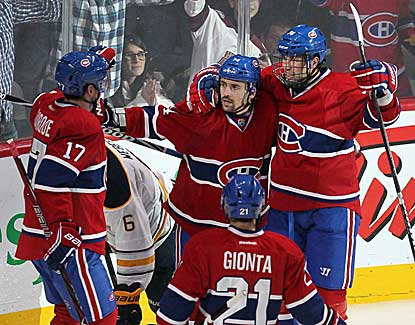 Rene Bourque (17) celebrates with teammates after scoring his second goal in Montreal's 6-1 win over Buffalo. (US Presswire)