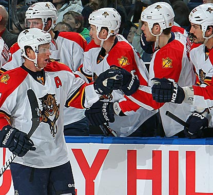 Former Sabres star Brian Campbell celebrates his game-winning goal with the Panthers bench.  (AP)