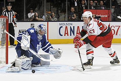 Toronto's James Reimer denies Jeff Skinner here, but Skinner winds up with three assists in Carolina's victory.  (Getty Images)