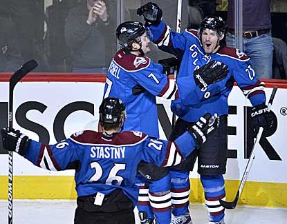 Colorado's Milan Hejduk (23) scores a goal in his 1,000th NHL game, but the Avs fall to the Stars. (US Presswire)