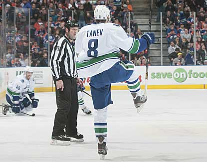 Vancouver's Chris Tanev scores 4:40 into overtime to lift the Canucks to their third straight win. (Getty Images)