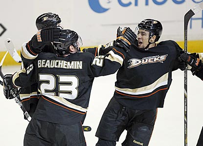 Sheldon Souray (left) is congratulated by Francois Beauchemin and Emerson Etem after scoring the go-ahead goal in the third.  (AP)