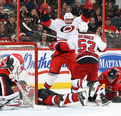 Jay Harrison beats Senators goalie Craig Anderson in overtime, winning a scrum in front of the net.  (Getty Images)