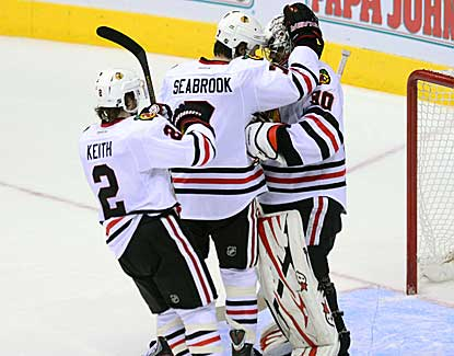 Duncan Keith and Brent Seabrook celebrate with goalie Ray Emery as the Hawks beat Phoenix.  (US Presswire)
