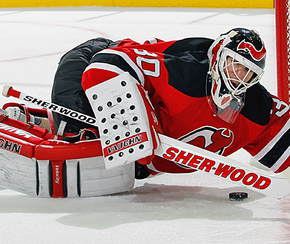 Martin Brodeur -- the first goalie to play in 1,200 games -- adds some comic relief, falling down at the end of the second.  (Getty Images)