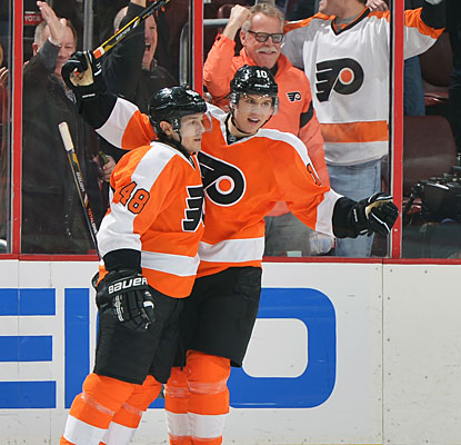 Danny Briere celebrates with Brayden Schenn after his game-winning goal in overtime for the Flyers.  (Getty Images)