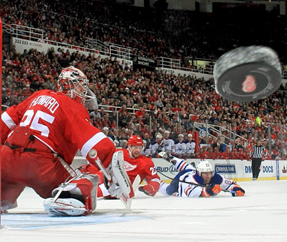 Jimmy Howard watches the puck sail into the corner after making one of his 23 saves against the Oilers.  (Getty Images)