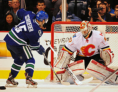 Vancouver rookie Jordan Schroeder scores his first two NHL goals in the Canucks' win over Calgary. (US Presswire)