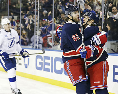 Carl Hagelin (right) has a big day for the Rangers. The left wing finishes with two goals and an assist. (AP)