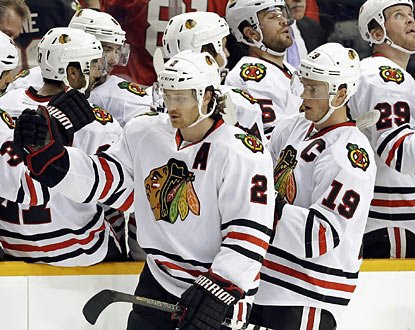 The Blackhawks' Duncan Keith (2) and Jonathan Toews (19) celebrate following Toews' goal in the second period. (AP)