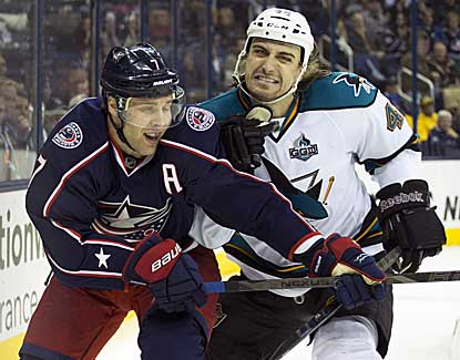 Sharks defenseman Matt Pelech puts a hit on Jack Johnson, who tallies an assist in Columbus' win. (US Presswire)