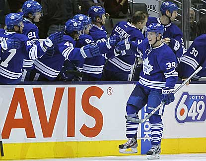 Leafs forward Matt Frattin celebrates with the Toronto bench after scoring a second-period goal. (US Presswire)