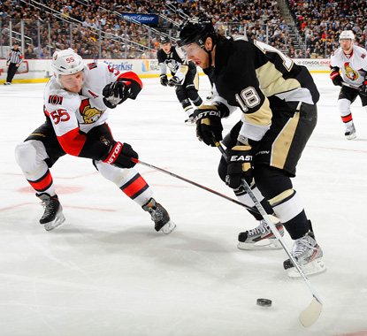 James Neal (right), who scores a pair of goals against the Senators, battles Sergei Gonchar for the puck. (Getty Images)