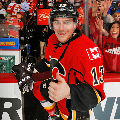 Mike Cammalleri celebrates his hat trick against the Stars, giving him 200 for his career. (Getty Images)