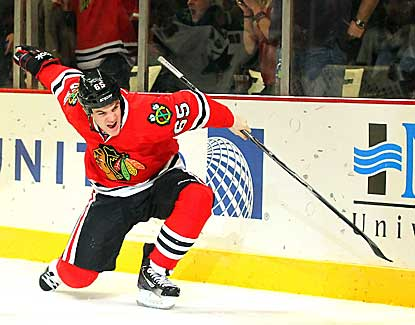 Chicago center Andrew Shaw scores in the second period as the Blackhawks remain unbeaten in regulation. (US Presswire)