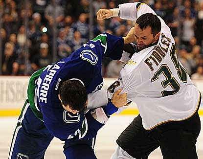 Dallas forward Vernon Fiddler throws down with Vancouver's Maxim Lapierre during a chippy second period. (US Presswire)