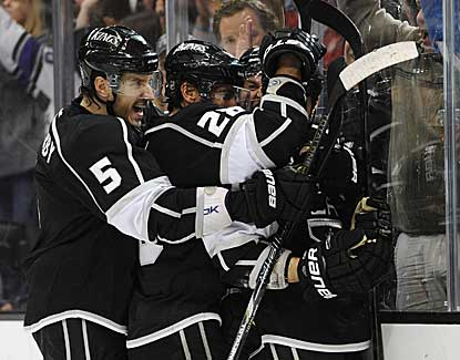 The Kings celebrate Kyle Clifford's second-period goal as Los Angeles crawls out of last place in the Western Conference. (US Presswire)