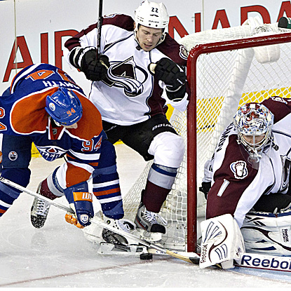 The Oilers use a team-record 56 shots to rally from a three-goal deficit to defeat the Avalanche. (AP)