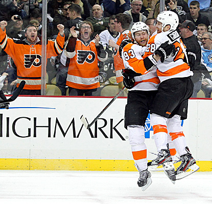 Claude Giroux (right) congratulates Jakub Voracek after Voracek scores the winning goal. (USATSI)