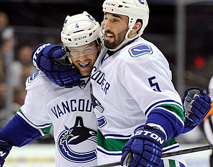 Vancouver's Jason Garrison scores a 3rd-period goal and celebrates with defenseman Keith Ballard. (USATSI)