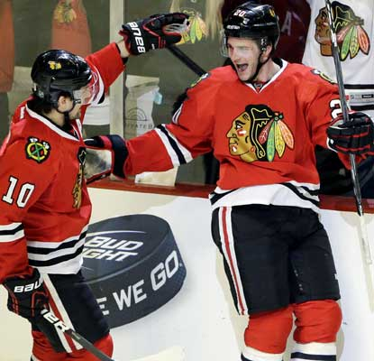 Brandon Saad scores a short-handed goal to snap a 1-1 tie and send the Hawks into the record books.  (AP)