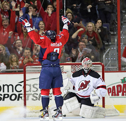 Alex Ovechkin enjoys the applause from Washington fans as he scores the second of three goals on the day against the Devils.  (Getty Images)