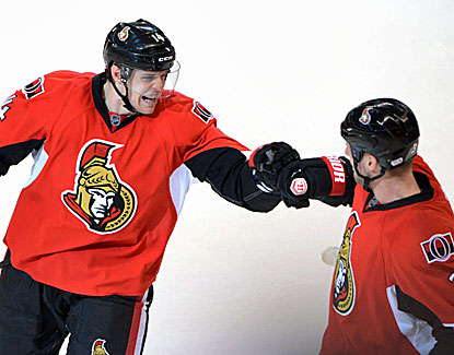 Ottawa's Colin Greening, left, celebrates his dramatic game-winning goal with teammate Marc Methot. (AP)