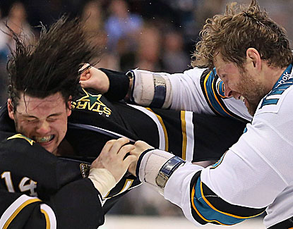 Dallas' Jamie Benn finishes with a goal and an assist to go with his fight with San Jose's Joe Thornton. (Getty Images)