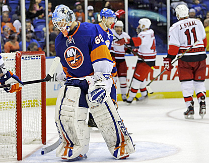 Islanders goalie Kevin Poulin reacts after Carolina's Bobby Sanguinetti scores the go-ahead goal, his first NHL goal. (AP)