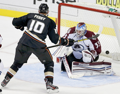 Anaheim's Corey Perry beats Colorado's Jean-Sebastien Giguere for the winning goal in overtime. (AP)