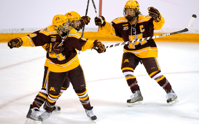Amanda Kessel (left) has led the University of Minnesota women's team to a perfect 34-0-0 record this season (Getty Images)