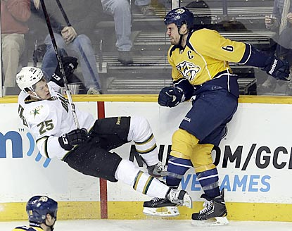 Nashville captain Shea Weber flattens Matt Fraser during the second period. Weber earns an assist on the overtime goal.  (AP)