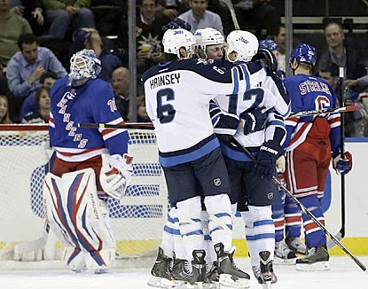The Jets congratulate Olli Jokinen (12) after one of his two goals he scores during the second period.  (AP)