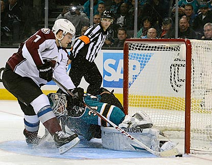 San Jose's Antti Niemi stones Colorado's John Mitchell to end the shootout in the Sharks' favor.  (Getty Images)
