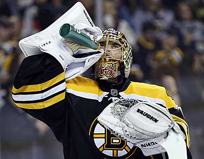 Bruins goalie Tuukka Rask makes 30 saves, including two tough stops in overtime, to help the Bruins to a 2-1 victory. (USATSI)