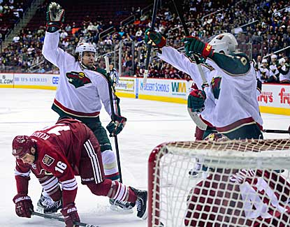 Wild winger Dany Heatley (left) scores the second of his two goals, which pushes Minnesota's lead to 3-1.  (USATSI)