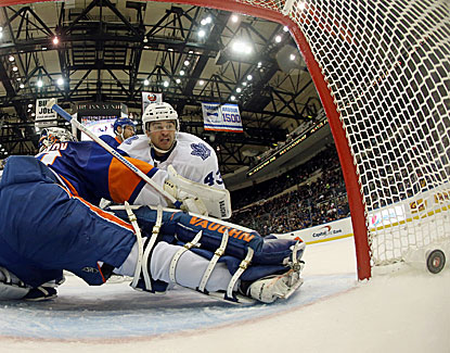Nazem Kadri logs his first hat trick, including this shot past Islanders goalie Evgeni Nabokov. (Getty Images)