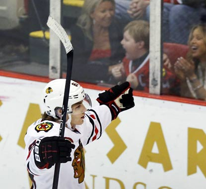 Patrick Kane makes the Blackhawks and some Chicago fans in Detroit very happy with his SO goal.  (AP)