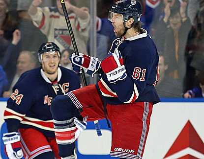 Rick Nash scores a goal, adds an assist and also scores in the shootout of the Rangers' win over the Sabres. (Getty Images)