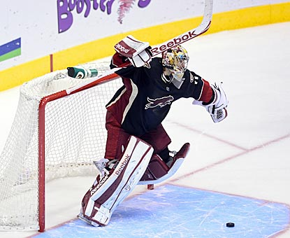 For the second time in a span of 48 hours, Coyotes goalie Mike Smith celebrates a 5-4 shootout victory against the Ducks.  (USATSI)