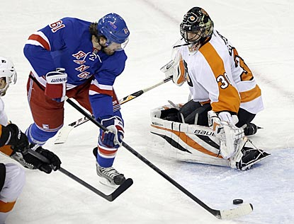 Rick Nash stickhandles around Ilya Bryzgalov before backhanding an insurance goal into the net for the Rangers.  (AP)