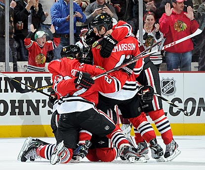 Daniel Carcillo (left) celebrates with teammates after giving Chicago its first lead of the game in the final minute.  (Getty Images)