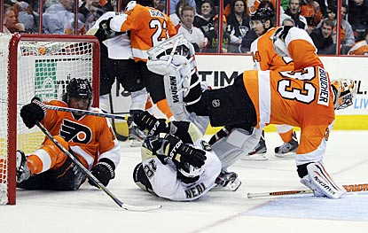 Philly's Scott Hartnell (left) and Pittsburgh's James Neal collide with Flyers goalie Brian Boucher during the third period.  (AP)