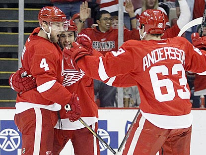 Detroit defenseman Jakub Kindl (4) celebrates with Niklas Kronwall and Joakim Andersson (63) after opening the scoring.  (AP)