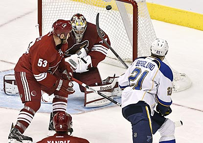 St. Louis center Patrik Berglund (21) gets his backhand shot up and over Phoenix goalie Mike Smith in the second period.  (AP)