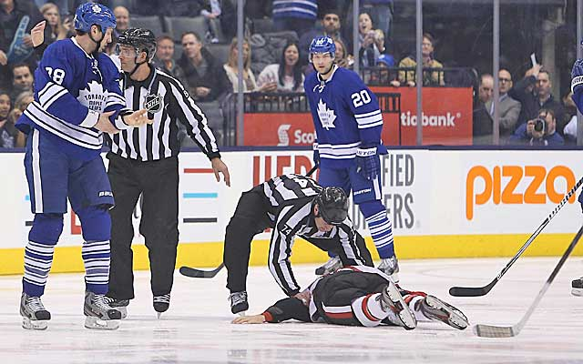 Ottawa's Dave Dziurzynski lays on the ice after being knocked out by Toronto's Frazer McLaren. (USATSI)