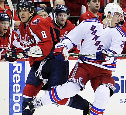 Alex Ovechkin (8) is again in the middle of the action, and Sunday in a game-turning, controversial double-minor.  (AP)